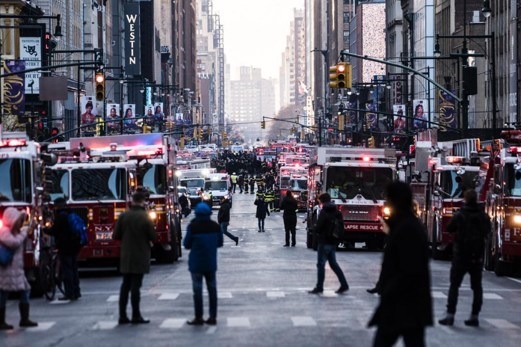 Firefighters arrive at the scene of the blast. Click to enlarge