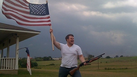 Flag-and-shotgun-guy
