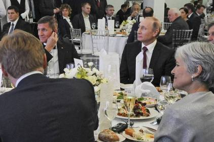 Retired Lt. Gen. Michael Flynn attending a dinner marking the RT network's 10-year anniversary in Moscow, December 2015, sitting at the same table as Russian President Vladimir Putin and Green Party leader Jill Stein. Click to enlarge