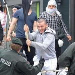Migrants attack German police. Click to enlarge
