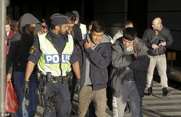 swedish cops welcome migrants at train station