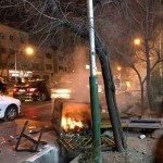 "A photo of a burning rubbish bin and a man, far right, holding a glass or bottle in the air, which the New York Times captioned: ""Unrest in the streets of Tehran on December 30, 2017"". Click to enlarge"