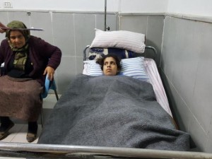 Lying in the Afrin hospital, 15-year old Dananda Sido, wounded in the legs and chest running in the street from a Turkish air attack in the Kurdish village of Adamo (Yara Ismail). Click to enlarge