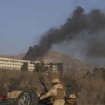Black smoke billows from the Intercontinental hotel in Kabul. Click to enlarge