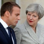 French President Emmanuel Macron (L) escorts Britain's Prime Minister Theresa May as they arrive to speak to the press at the Elysee Palace in Paris, France, June 13, 2017.    REUTERS/Philippe Wojazer