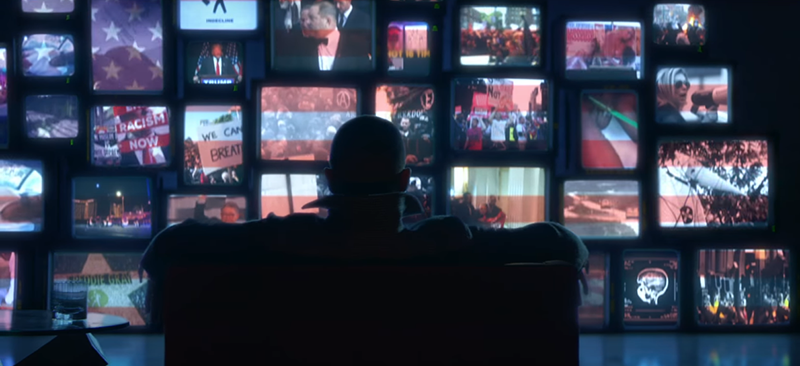 At the beginning of the video, Justin watches several screens at one, all of which display events of the past year: Trump, Harvey Weinstein, anti-racism demonstrations, gun control, the Vegas shooting, etc. Click to enlarge