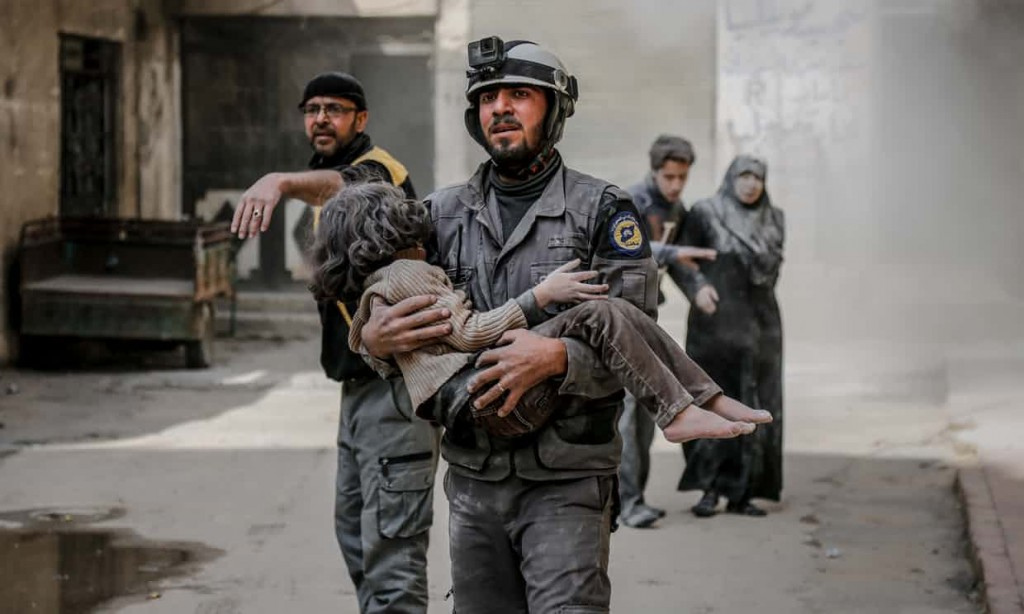 A rescue worker carries a girl who was found alive inside the debris of buildings in eastern Ghouta. Or so the Gaurdian claims. Click to enlarge