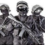Russian special forces operators in black uniform and bulletproof helmets