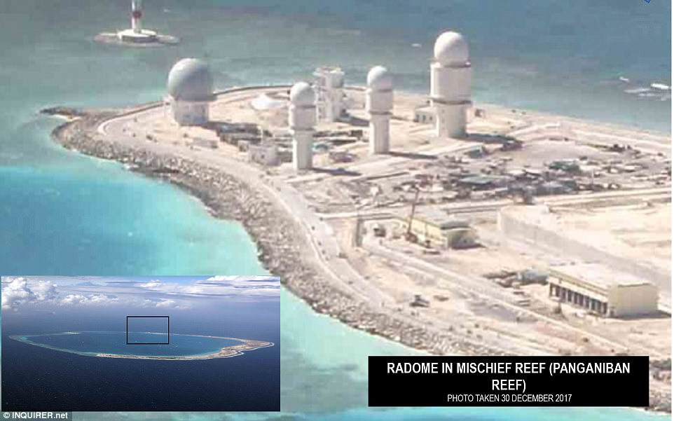 Beijing claims nearly all of the waterway and has been turning reefs and islets into islands and installing military facilities such as runways and equipment on them, such as this radome on Panganiban Reef. Click to enlarge