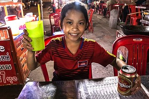 12-year-old Cambodian waitress. Click to enlarge