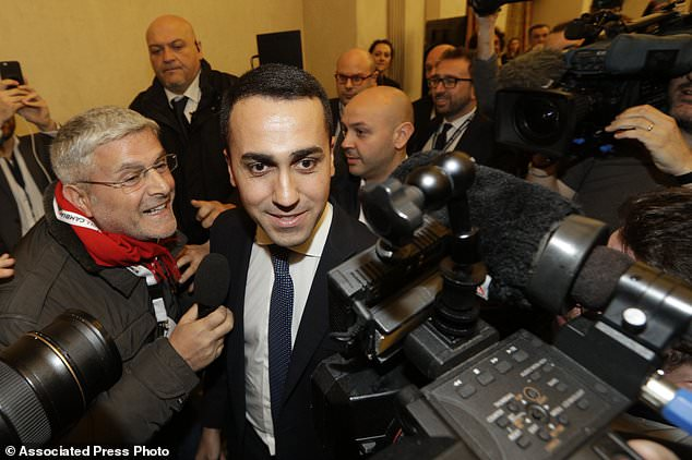 5-Stars Movement's leader Luigi Di Maio arrives for a press conference on the preliminary election results, in Rome, Monday, March 5, 2018. Click to enlarge