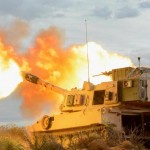 An M109 Paladin gun crew with B Battery, 4th Battalion, 1st Field Artillery Regiment, Division Artillery, at Fort Bliss, Texas, fires into the mountains of Oro Grande Range Complex, New Mexico, on Feb. 14, 2018.(U.S. Army photo by Spc. Gabrielle Weaver) Click to enlarge