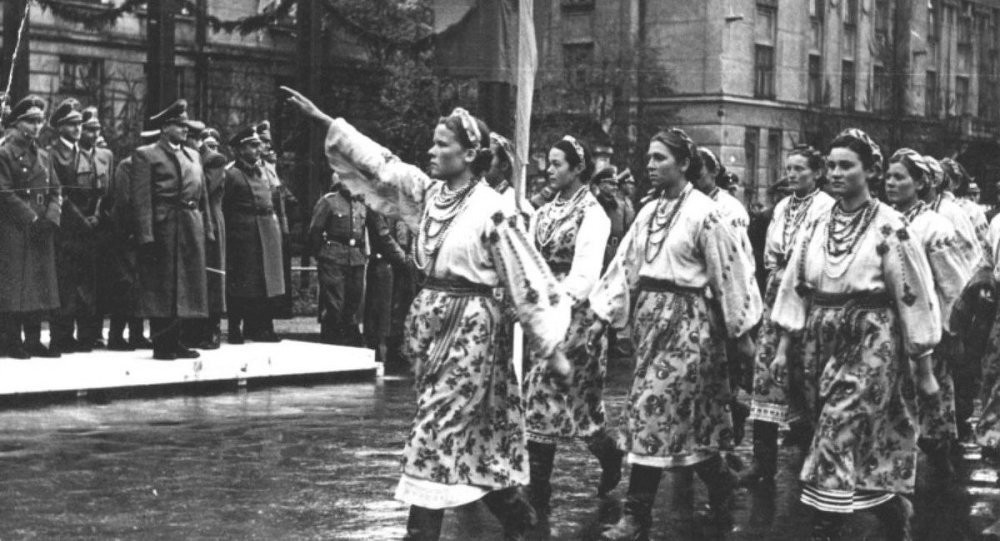 Ukranian women greet occupying Nazis. Click to enlarge