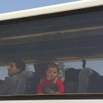 Miltantsi leave for Idlib province with their families. Click to enlarge