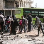 Militants wives and families prepare to evacuate Eastern Ghouta in buses. Were British Special Forces among them disguised behind veils? Click to enlarge