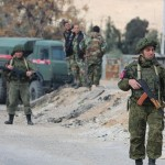 Russian military police and Syrian government forces at a checkpoint on the outskirts of Damascus. Click to enlarge