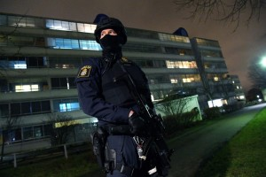 An armed police officer stands guard after an object exploded next to a police station in Rosengard in Malmo, Sweden on January 17, 2018.  / AFP PHOTO / TT News Agency / Johan NILSSON / Sweden OUT        (Photo credit should read JOHAN NILSSON/AFP/Getty Images) Click to enlarge
