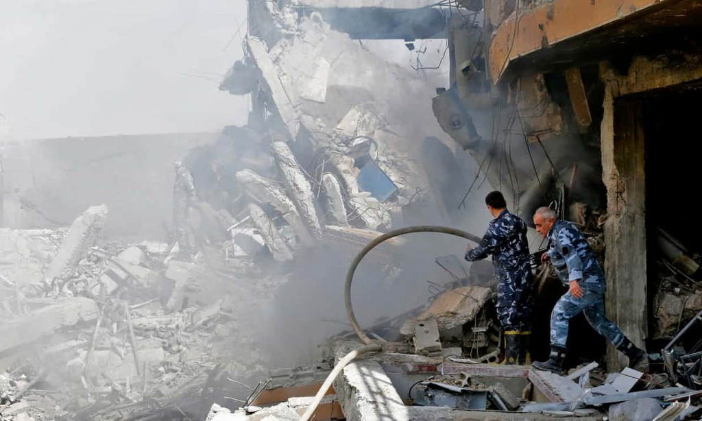 Syrian soldiers inspect the ruins of the Barzah research facility. Click to enlarge