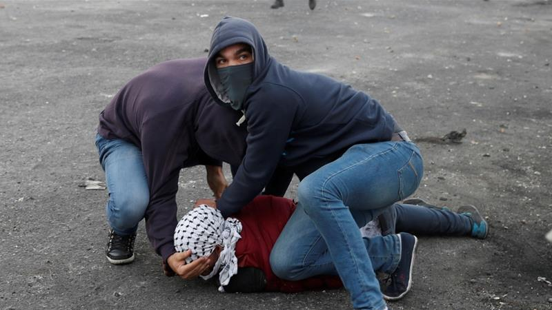 Undercover Israeli security agents detain a Palestinian protester near the West Bank city of Ramallah. Click to enlarge