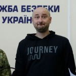 Arkady Babchenko, centre, at a press confence where it was revealed that his death had been staged. Click to enlarge