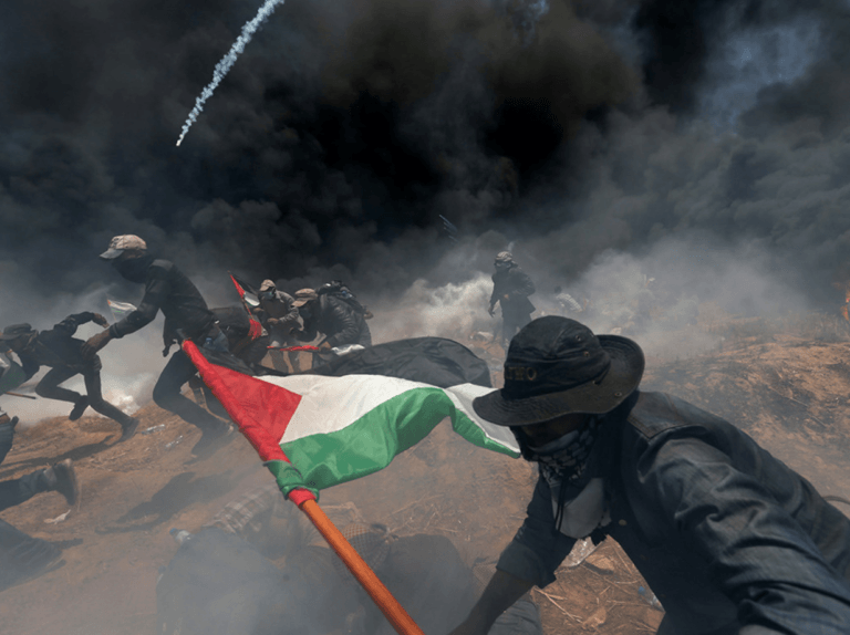 Meanwhile dozens of Palestinians are killed during protests on Israel's border with Gaza. Click to enlarge