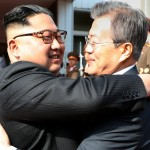 Kim Jong-un and south Korean President Moom Jae-in meet inside the Demilitarized Zone between North and South Korea, Saturday. Click to enlarge