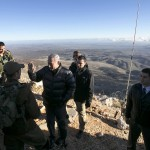 Israel's Prime Minister Benjamin Netanyahu, center, talks with Israeli soldiers at a military outpost during a visit at Mount Hermon in the Israeli-controlled Golan Heights overlooking the Israel-Syria border on Wednesday, Feb. 4, 2015. (AP Photo/Baz Ratner, Pool)