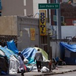 In Los Angeles tents and cardboard shelters litter the sidewalks of many city streets. On skid row, entire city blocks are occupied by tens of thousands of homeless men and women, eighty-percent of them black. Click to enlarge