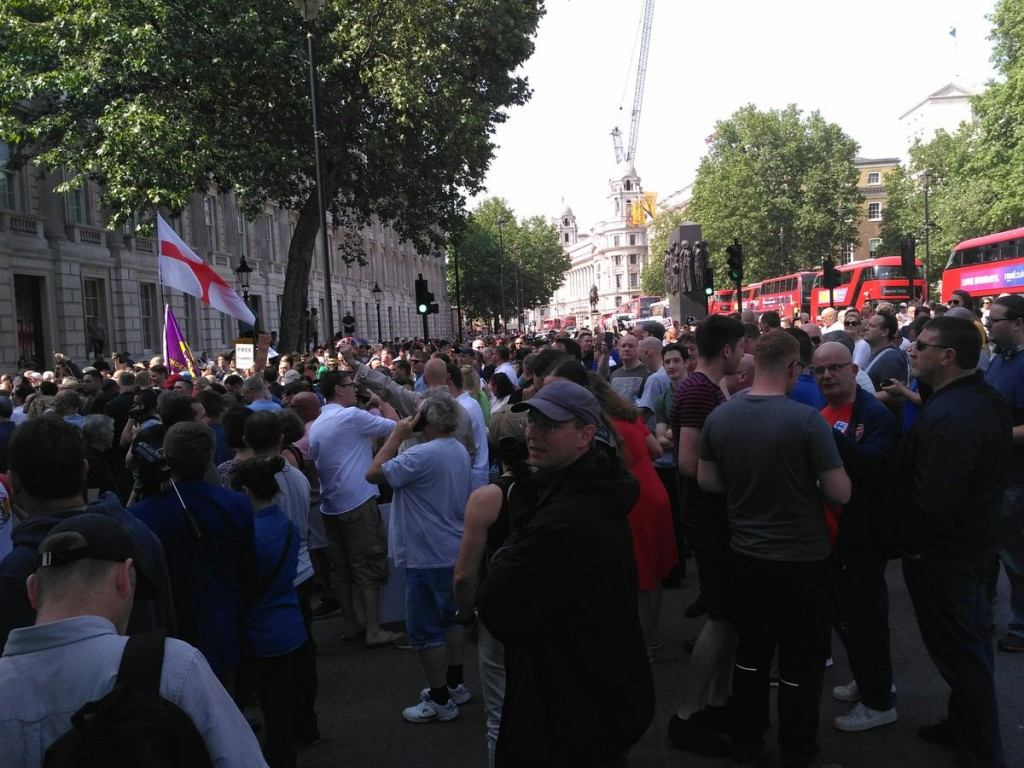 Protestors gather outside Downing Street. Click to enlarge