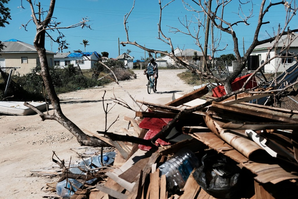 Debris from damaged homes lines a street on the nearly destroyed island of Barbuda on Dec. 8, 2017, in Codrington, Barbuda. Click to enlarge