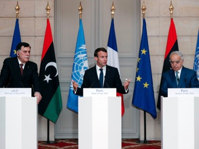 Final Press conference of the Paris summit, 29 May. From left to right: Fayez Al-Sarraj (President of the Libyan Government of National Accord, designated by the UN), Emmanuel Macron (President of the French Republic), Ghassan Salame (UN official). These three men, who have no elective legitimacy in Libya, hope to decide the future of the Libyan People.