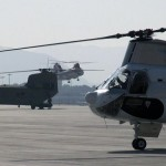 Helicopters await passengers at Kabul International Airport to ferry them 2 miles to the U.S. compound. Click to enlarge