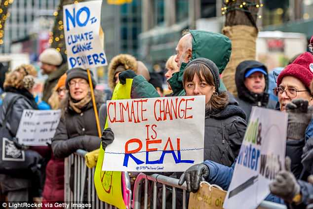 """Love the way the protestors in this demonstration against """"climate change denial"""" are all well wrapped with woolies, gloves and hats. """"global warming"""" obviously isn't affecting them. Click to enlarge"""