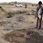 A Yemeni child looks at the site of a Saudi airstrike in the Sahar district of Sa'ada Province on July 19, 2018. Click to enlarge