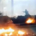 A still from a video of a protester in Khorramshahr on Saturday carrying what looks like an assault rifle. Click to enlarge