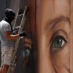 Italian graffiti artist arrested for mural of Ahed Tamimi on security barrier
