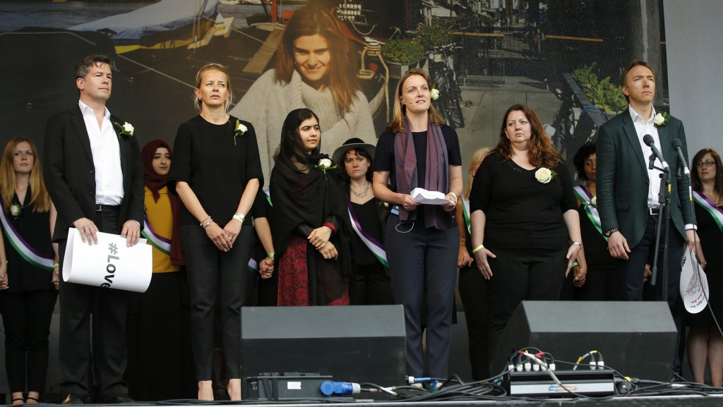 Nick Grono, left, Mabel van Oranje, second left, and Tim Dixon, right stand on stage with others at a a Jox Cox commemoration at Trafalgar Square in London. Alastair Grant   AP