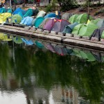 Tents in which migrants live are seen in a makeshift camp along the Quai de Valmy of the canal Saint-Martin. Click to enlarge