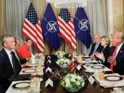 Convened at the residence of the US ambassador in Brussels by President Trump, the Secretary General of NATO, Jens Stoltenberg, was told off in public for his incapacity to maintain the political coherence of the Alliance.