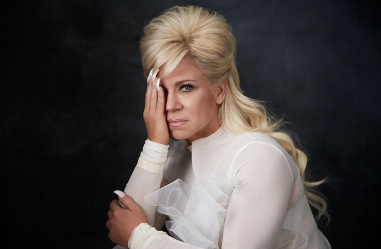 Theresa Caputo aka The Long Island Medium does a big fat one-eye sign in Paper Magazine. Why? Because that's what's you need to do to stay in the biz. Click to enlarge