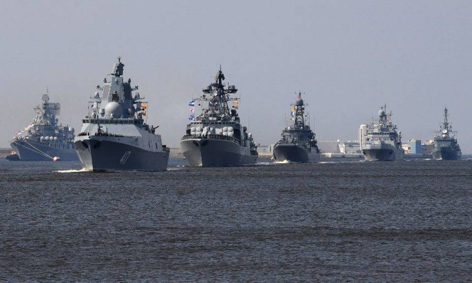 Russian warships, among them the frigate Admiral Gorshkov (second left), sail near Kronshtadt naval base outside St Petersburg on July 20, 2018, during a rehearsal for the Naval Parade. Photo: AFP / Olga Maltseva. Click to enlarge