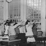 Students pledging allegiance to US flag, May 1942