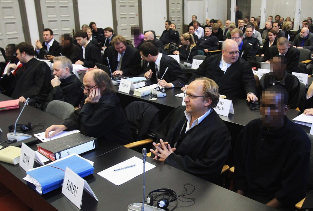 The accused Somalis and their lawyers are seen before the opening of the trial against Somali pirates at Hamburg Regional Court on November 22, 2010, in Hamburg, Germany. Click to enlarge