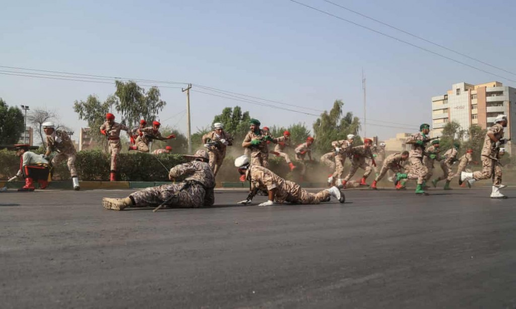 Iranian soldiers react to the attack. click to enlarge