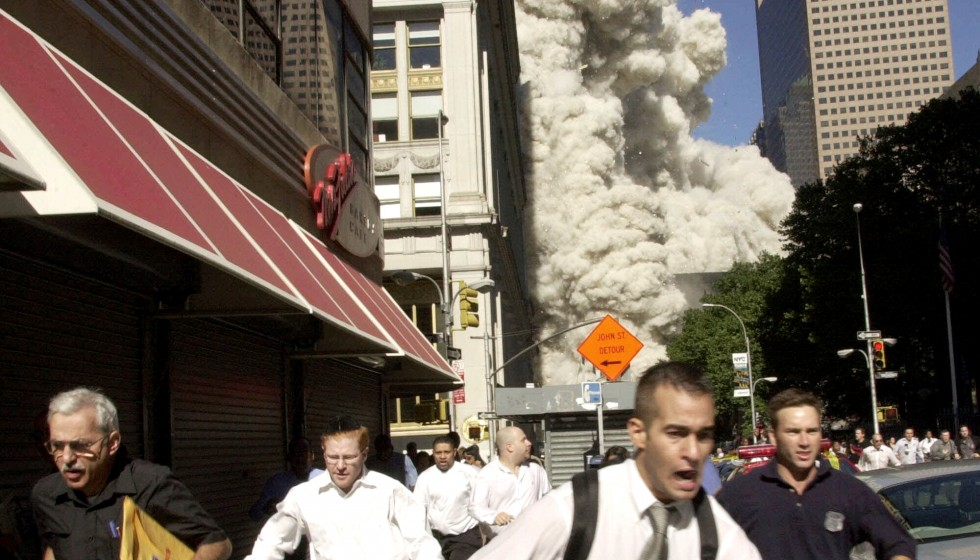 New-Yorkers-Flee-World-Trade-Center-Attack-980x560-c-default