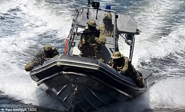 Russian Navy Spetsnaz (pictured) are trained in underwater warfare, including laying mines. They can deploy in rigid surface vessels and underwater vehicles narrow enough to pass through a torpedo tube. Click to enlarge