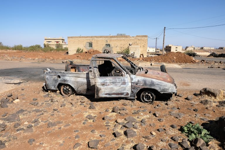 A car at the entrance to Shbeki village had been targeted by ISIS terrorists as it was attempting to ferry injured civilians to safety. (Photo: Vanessa Beeley). click to enlarge