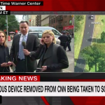 News hosts continue to broadcast outside CNN's New York headquarters after the building was evacuated following the discovery of a suspected pipe bomb. Click to enlarge