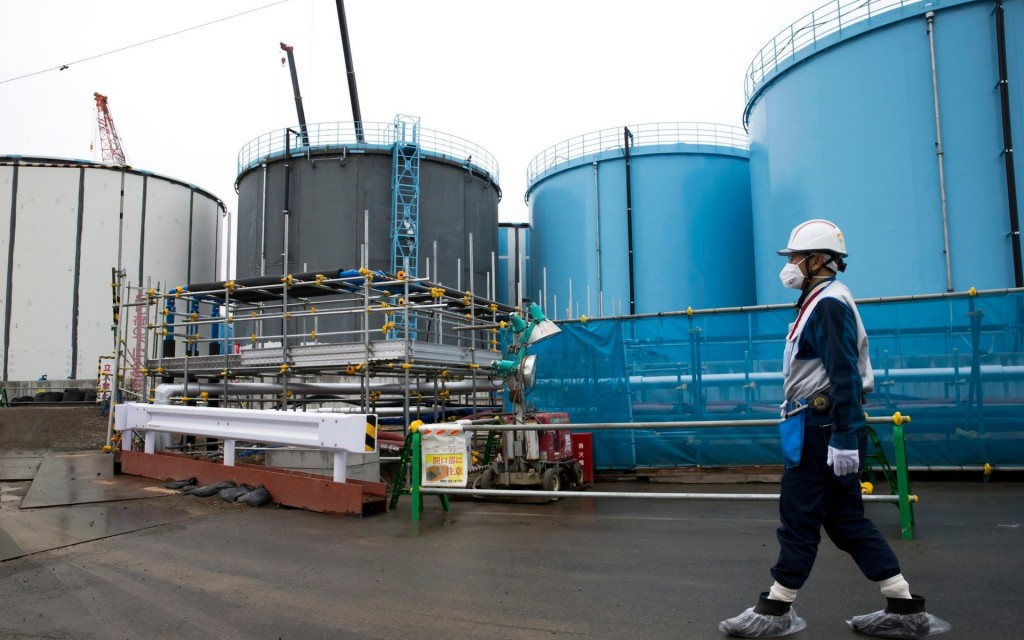 Storage tanks for contaninated water at the site of the tsunami wreaked Fukushima plant. Click to enlarge