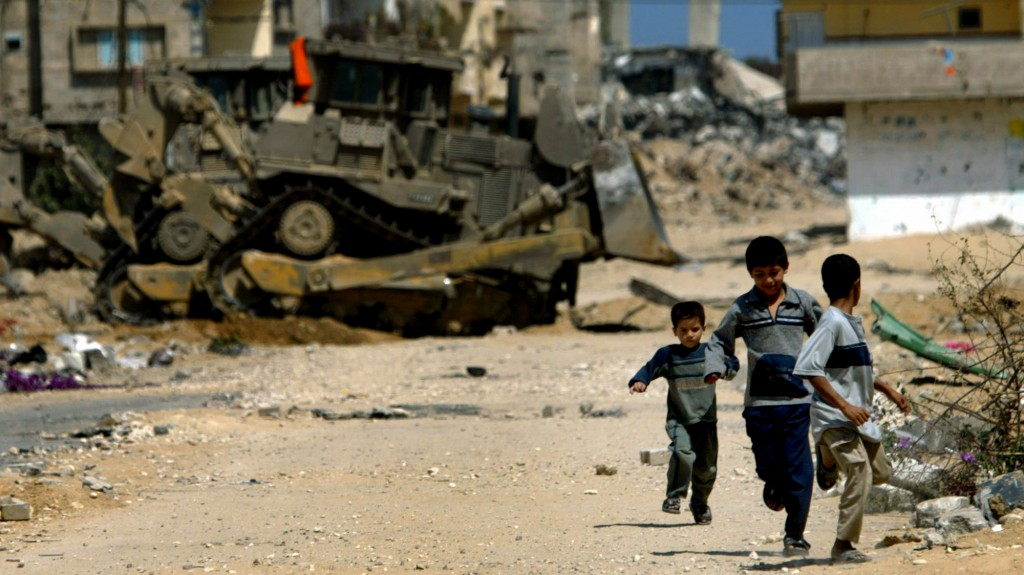 "** FILE ** Palestinian children run for cover as Israeli army D-9 bulldozers advance at the rubble of previously demolished houses and damaged roads, at the Brazil neighborhood of Rafah's refugee camp, in the southern Gaza Strip, in this Sunday May 23, 2004 file photo. Human Rights Watch, an international human rights group has called on American heavy-equipment maker Caterpillar Inc. to suspend bulldozer sales to the Israeli military, citing the army's use of the vehicles as the army's ""primary weapon"" in home demolitions, destruction of farmland and ruining Palestinian roads and sewage pipes. The 64-ton bulldozers are built to military specifications and enforced with armor by the army. (AP Photo/Lefteris Pitarakis, file)"